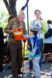 Portrait of a war veteran. He offers sweets to a boy. Royalty Free Stock Images
