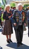 Portrait of a war veteran standing by a blond woman. Stock Photos