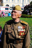 Portrait of a war veteran wearing many medals. Stock Image