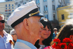 Portrait of a war veteran in white hat. Stock Photos