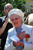 Portrait of a war veteran woman. She sing songs. Stock Image