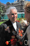 Portrait of a war veteran woman speaking to another woman. Royalty Free Stock Images