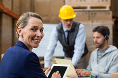 Portrait of warehouse manager using digital tablet. In warehouse Royalty Free Stock Photo