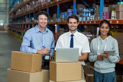 Portrait of warehouse manager and worker standing together. In warehouse Royalty Free Stock Photos