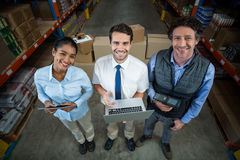 Portrait of warehouse manager and worker standing together. In warehouse Stock Image