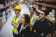 Portrait of warehouse manager and workers Stock Photo