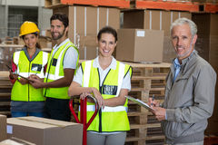 Portrait of warehouse manager and workers preparing a shipment Stock Photo