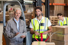 Portrait of warehouse manager and workers preparing a shipment Stock Photography