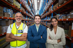 Portrait of warehouse team standing with arms crossed Royalty Free Stock Image