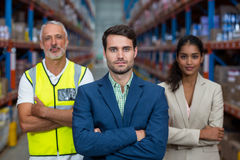 Portrait of warehouse team standing with arms crossed Royalty Free Stock Photos