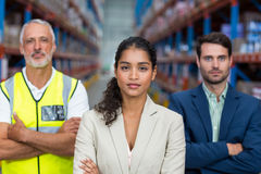 Portrait of warehouse team standing with arms crossed Royalty Free Stock Photography