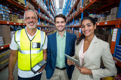 Portrait of warehouse team standing with digital tablet and barcode scanner Stock Photo