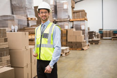 Portrait of warehouse worker with clipboard. In warehouse Royalty Free Stock Photos