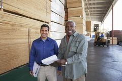 Portrait Of Warehouse Workers Holding Clipboards Royalty Free Stock Images