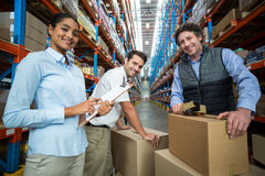 Portrait of warehouse workers preparing a shipment Royalty Free Stock Photo