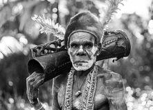 Portrait of a Warrior Asmat tribe with a ritual drum. royalty free stock photography
