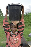 Portrait of water carrying Ghanaian boy, Ghana Stock Photography