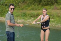 Portrait water skier holding rope with instructor. Portrait of water skier holding rope with instructor Royalty Free Stock Photos