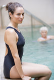 Portrait Of A Water Therapy Instructor. On Side Of Pool Royalty Free Stock Photography