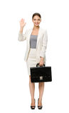 Portrait of waving hand businesswoman with case Stock Photography