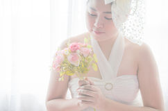 Portrait Wedding asian woman. Beautiful bride with bouquet Royalty Free Stock Photography