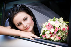 Portrait in the wedding car Stock Images
