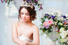 Portrait, wedding hair style, brunette with curly hair. Beautiful girl in a wedding dress. Close-up Royalty Free Stock Images