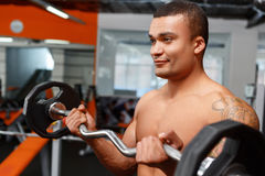 Portrait of weightlifter with barbell in his hands Stock Photos