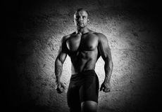 Portrait of a weightlifter who poses without a shirt. Front view Stock Photography