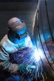 Portrait of a welder. Front image of welder welding on tanker Royalty Free Stock Image