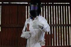 Portrait of welder in safety uniform showing thumbs up posing. Portrait of welder in safety uniform showing thumbs up posing Stock Photos
