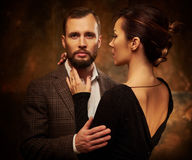 Portrait of well-dressed couple in expression of feelings Stock Image