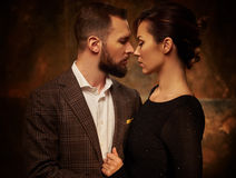 Portrait of well-dressed couple in expression of feelings Royalty Free Stock Photo