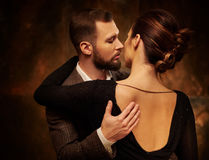 Portrait of well-dressed couple in expression of feelings Royalty Free Stock Images