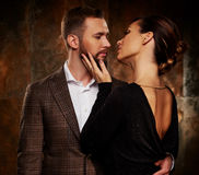 Portrait of well-dressed couple in expression of feelings Royalty Free Stock Photos