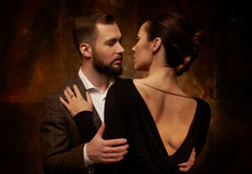 Portrait of well-dressed couple in expression of feelings Stock Images