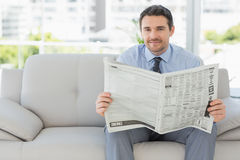 Portrait of a well dressed man reading newspaper Stock Photo