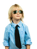 Portrait of a well-dressed young boy looking up. Portrait of a well-dressed cute boy wearing sunglasses and a shirt and tie looking up at copy space. Isolated on royalty free stock images