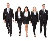 Portrait of welldressed businesspeople walking Royalty Free Stock Photos