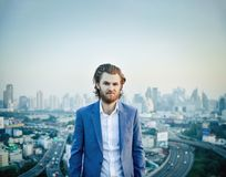 Portrait of Western businessman with blurry city background.  Royalty Free Stock Photo
