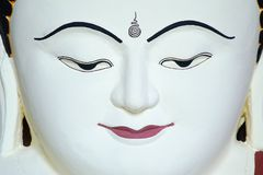 Portrait of White Buddha Face. Burmese Buddha Temple Royalty Free Stock Photo