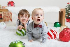 Caucasian children brothers celebrating Christmas or New Year royalty free stock photography