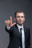 Portrait of white collar pointing hand gestures Royalty Free Stock Image