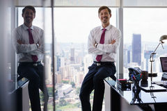 Portrait Of White Collar Worker Smiling At Camera In Office Stock Photography