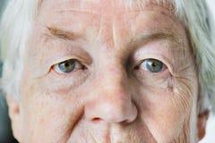 Portrait of white elderly woman closeup on eyes Royalty Free Stock Photos