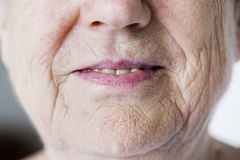 Portrait of white elderly woman closeup on smiling lips royalty free stock image