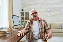 Nice Senior Man Sitting by Computer Stock Photography