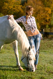 Portrait of a white horse and woman Royalty Free Stock Images