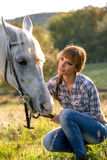 Portrait of a white horse and woman royalty free stock photo
