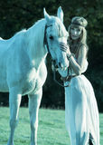 Portrait of a white horse and woman Royalty Free Stock Photography